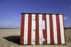 Budget vacation property. Striped beach hut. Stock Photos