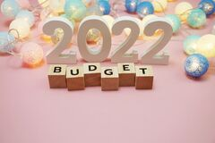 Budget 2022 word alphabet letters on pink background
