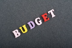 BUDGET word on black board background composed from colorful abc alphabet block wooden letters, copy space for ad text stock images