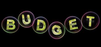 The budget word in bubble. The budget word in soap bubble on black background,3d rendered Stock Photography