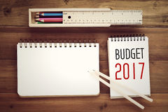 2017 budget word on notebook paper background Stock Photos