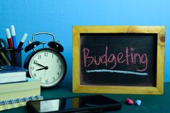 Budgeting Planning on Background of Working Table with Office Supplies. Business Concept Planning on Blue Backgroundn royalty free stock photography