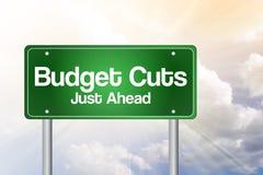 Budgetnedskärningar gör grön vägmärket Arkivfoton