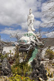 Budha. Sculpture of Budha on the top of the dragon Stock Photography