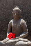 Budha with red flower Royalty Free Stock Photography