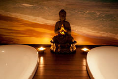 Budha in a SPA center. And beach background Stock Photos