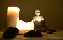 Budha. Statue of Buddha with stones by candlelight Stock Photos