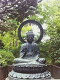 Budha statue. Large statue of Budha inside tea garden Stock Photo