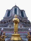 Budha statue stand front of pagoda Royalty Free Stock Photography