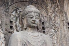 Budhas staty på Longmen grottor, Luoyang, Henan, Kina Royaltyfri Fotografi