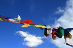 Budhist sacred flags. Beautiful shot of budhist sacred flags against blue sky royalty free stock images