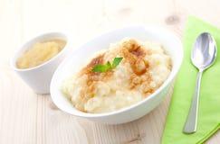 Budino di riso e purè della mela Fotografie Stock