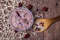 Budino di riso ed ingredienti dei cereali Immagini Stock