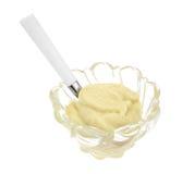 Budino di vaniglia in ciotola con il cucchiaio Immagine Stock