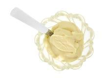 Budino di vaniglia in ciotola con il cucchiaio Fotografia Stock