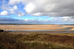 Budle bay in Northumberland. Low Tide at budle Bay in Northumberland Royalty Free Stock Photography