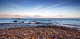 Budliegh Beach at sunset Royalty Free Stock Photography