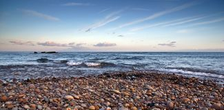 Budliegh Beach at sunset Stock Photos