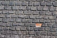 Budować ścienny z nierównymi ceglanymi kamieniami obraz royalty free