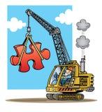 Budowa żuraw podnosi wielkiego czerwonego łamigłówki piec Fotografia Stock