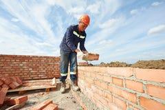Budowa kamieniarza pracownika murarz obrazy royalty free
