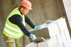 Budowa kamieniarza pracownika murarz zdjęcie royalty free