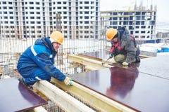 Budowa placu budowy pracownicy obraz royalty free