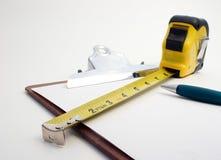 budowa szacuje się narzędziem pomiaru Obraz Stock