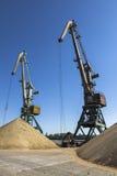 Budowa żuraw blisko stosu piasek Obrazy Stock