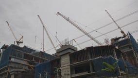 Budowa z żurawiami Fotografia Royalty Free