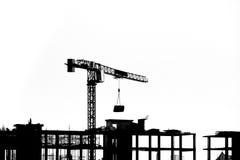Budowa z żurawiami na sylwetki tle Obraz Royalty Free