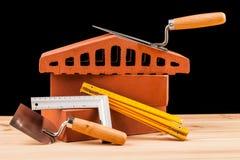 Budowniczych narzędzia na czarnym tle Fotografia Stock
