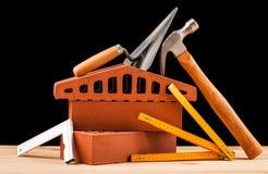Budowniczych narzędzia na czarnym tle Obrazy Stock