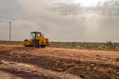 Budowy maszyneria na budowie nowa droga przy Zdjęcie Royalty Free