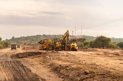 Budowy maszyneria na budowie nowa droga przy Zdjęcia Royalty Free