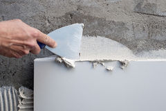 budowy szpachelki płytki kielni praca fotografia stock