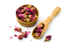 Buds of dried roses for tea in a wooden bowl Royalty Free Stock Photos