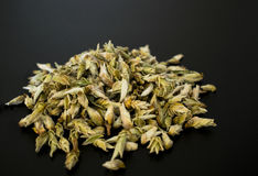 Buds white tea on a black table Royalty Free Stock Photography