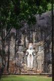 Buduruwagala temple. With well preserved carvings on the wall in Wellawaya Sri Lanka Stock Image