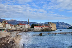 Budva beach near old town wall and fortress in winter season Stock Images