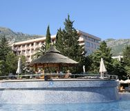 BUDVA, BECICI, MONTENEGRO –  A swimming pool, the Iberostar Bellevue Resort Hotel. Great and well-maintained holiday retreat. Enjoys a smashing location on Royalty Free Stock Photo