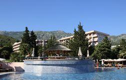 BUDVA, BECICI, MONTENEGRO –  A swimming pool, the Iberostar Bellevue Resort Hotel. Great and well-maintained holiday retreat. Enjoys a smashing location on Royalty Free Stock Images