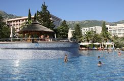 BUDVA, BECICI, MONTENEGRO –  A swimming pool, the Iberostar Bellevue Resort Hotel. Great and well-maintained holiday retreat. Enjoys a smashing location on Stock Photos