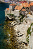 Budva fortress architecture. Old building of Budva citadel or fortress on rocky coastline  on a summer day, Montenegro Stock Photos