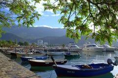 Budva marina view,Montenegro. Fishing boats and luxury yachts anchored at Budva marina at early morning ,Montenegro royalty free stock photo