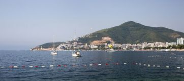 Panorama of the sea coast of the city Stock Photos