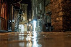 Budva, Montenegro - February 2, 2019. The cobbled street of the old city is illuminated at night by lantern light.  royalty free stock images