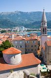 View of Church of St Ivan, Budva old town, mountains and sea. Montenegro. Budva, Montenegro - July 12, 2016: View of Church of St Ivan, Budva old town, mountains stock images