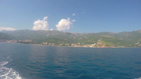Budva, Montenegro -June 28 2016: Adriatic Sea and mountains. View from the boat. 4k clip stock footage