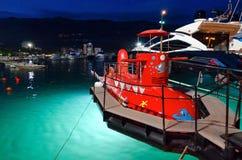 Boats at pier on promenade of resort of Budva, Montenegro, evening view Royalty Free Stock Photos